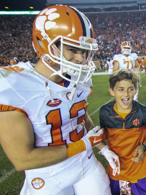 Clemson wide receiver Hunter Renfrow (13), left, celebrates with teammates and Clay Swinney, right, after the game on Saturday October 29 at Doak Campbell Stadium in Tallahassee, Florida.