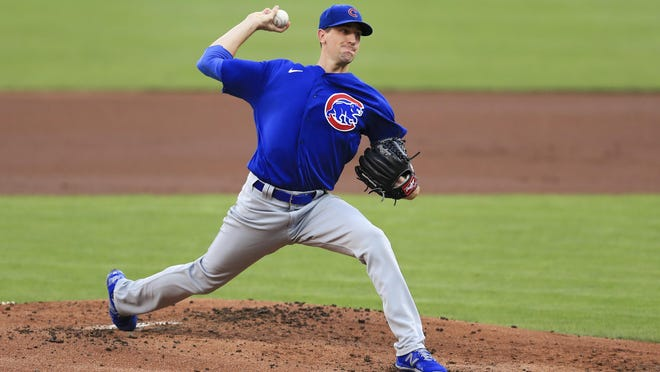Chicago Cubs' Kyle Hendricks throws in the first inning during a baseball game against the Cincinnati Reds in Cincinnati, Wednesday, July 29, 2020.