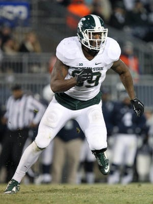 Nov 29, 2014; University Park, PA, USA; Michigan State Spartans defensive end Shilique Calhoun (89) during the fourth quarter against the Penn State Nittany Lions at Beaver Stadium. Michigan State defeated Penn State 34-10. Mandatory Credit: Matthew O'Haren-USA TODAY Sports
