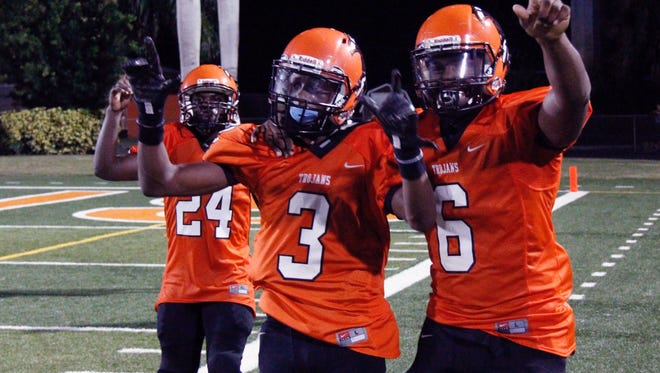 Lely's Jean Joseph (3) celebrates with teammates after a defensive stand during a game last year. Joseph returns to the Lely squad this year as a senior, and is expected to be one of the team leaders, both on and off the field.