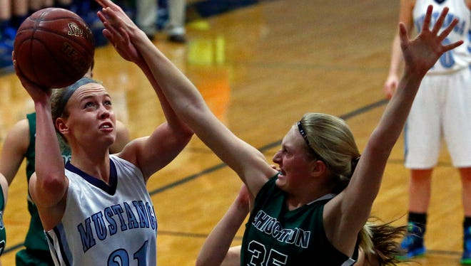 Little Chute's Abbie Botz goes up for a shot while being defended by Athena Ubl of Shiocton in a nonconference girls' basketball game at Little Chute High School on Dec. 30.