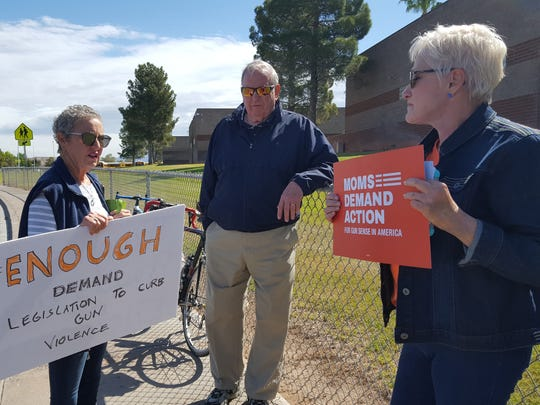 Virgin Valley Action Group members hold signs expressing displeasure with current gun control laws at the National School Walkout event at Virgin Valley High School on April 20