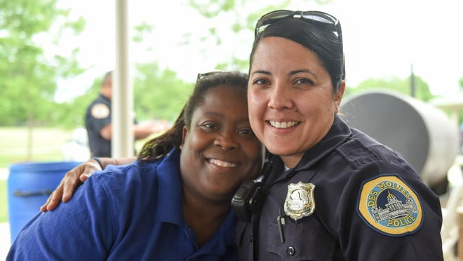 Officers Yanira Scarlett poses with Robin Moon of Tastee Morsles in May during the Safe Summer Kickoff celebration at Evelyn Davis Park. Scarlett was recently promoted to sergeant.