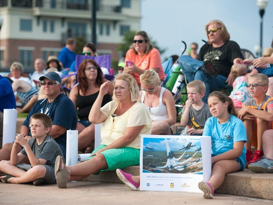 A crowd listens as former NAS Pensacola Commanding Officer and former Lead Solo Keith Hoskins and Blue Angels #5 Lt. Ryan Chamberlain answer questions from the public during an event in Pensacola, FL on Monday, July 11, 2016.