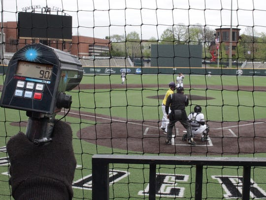A scout for the Detroit Tigets uses a radar gun to clock the pitches of Loretto's Ryan Weathers on Mon. April 16, 2018.  Photo by Dave Cardaciotto