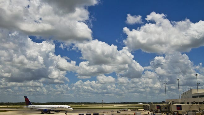 A Delta Airlines plane arrives at Southwest Florida International Airport Thursday afternoon.