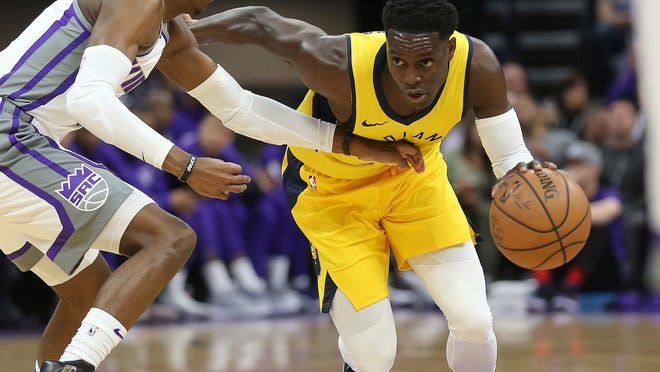 Indiana Pacers guard Darren Collison, right, tries to drive against Sacramento Kings guard De'Aaron Fox during the first quarter of an NBA basketball game, Saturday, Dec. 1, 2018, in Sacramento, Calif. (AP Photo/Rich Pedroncelli)