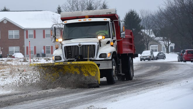 A City of Newark snowplow clears Moull Street on Monday, Jan. 8, 2018. Licking County was under a Level 1 Snow Emergency after slick roads and a wintry mix of precipitation made driving hazardous.