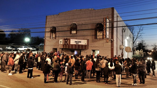 A vigil is held in January at Centennial Hill Bar and Grill after three people were shot to death there.