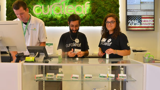 Dispensary associates Lee Ramsey, Paul Weintraub and Ashley Falto at the counter in Curaleaf,  the first medical marijuana dispensary to open in Brevard.  The dispensary opened Wednesday with a soft opening and a grand opening Thursday. The dispensary, on Palm Bay Road, had more than 50 customers by mid- afternoon Thursday.