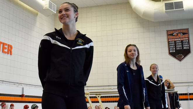 Ashwaubenon's Emma Steffel, left, on podium after placing first in the 200-yard freestyle with a personal -best time of 1:59.53 during the WIAA Division 2 sectional meet in Plymouth on Saturday. Also shown is Brookfield's Gabby Hrdlick (middle) and Ashwaubenon's Kyra Goedken.