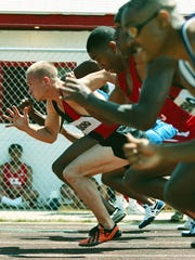 Casey Combest of Owensboro High School bursts out of the blocks during the 1998 Daviess County Invitational track meet.
