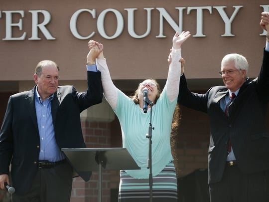 Rowan County, Ky., court clerk Kim Davis holds her