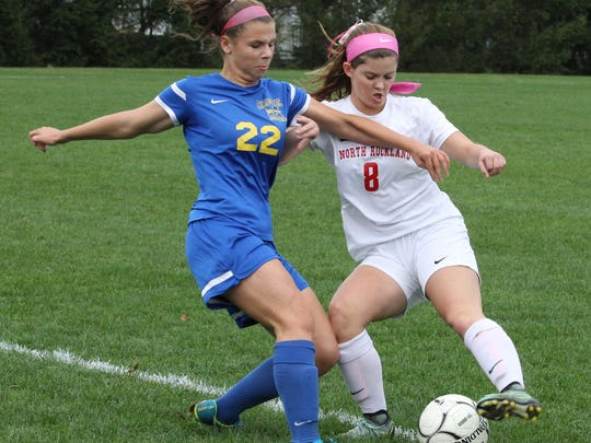 Mahopac's Carly Steinberg, left, fights for the ball with North Rockland's Jenna MacMillan during their Section 1 Class AA girls soccer quarterfinal at North Rockland Oct. 25, 2017. Mahopac won 2-1.