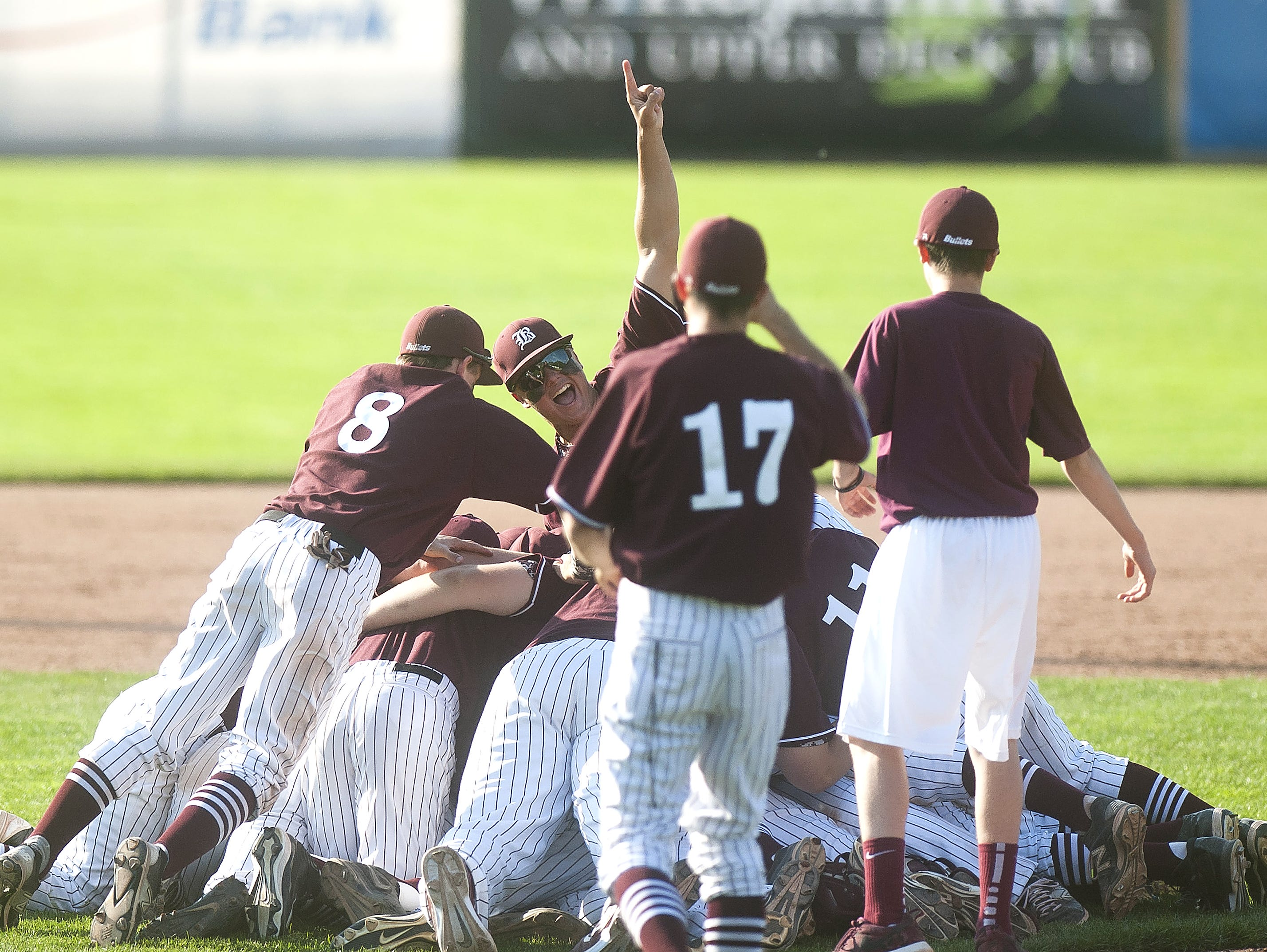 BFA-Fairfax players celebrate after the final out of their 13-3 victory over Williamstown in the Division III high school baseball state championship game on Saturday at Centennial Field.