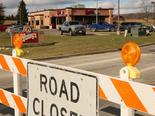 The new Thornwood Crossing interchange forces traffic away from several businesses, including Wendy's, Bob Evans, Arby's, and Speedway, near the old intersection of Ohio 16 and Cherry Valley Road.