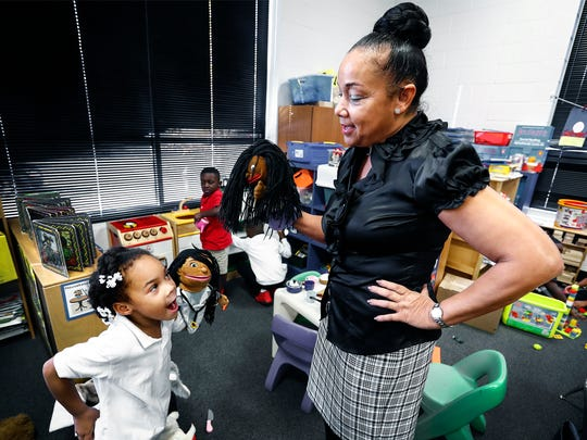Downtown Elementary School principal Debra Martin (right) plays puppets with kindergarten student Harmony Anderson, 5, Thursday afternoon.