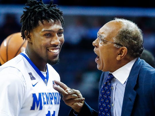 Memphis head coach Tubby Smith lays into guard Malik Rhodes (left) during action against Bryant at the FedExForum in Memphis Tenn., Saturday, December 9, 2017.