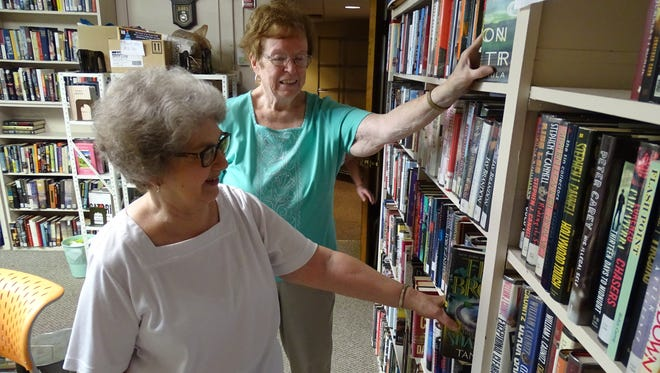 Roberta Siniff, left, and Maureen Sharrock, who are vice president and president, respectively, of the Friends of the Bucyrus Public Library, organize books Tuesday ahead of the club's upcoming book sale.