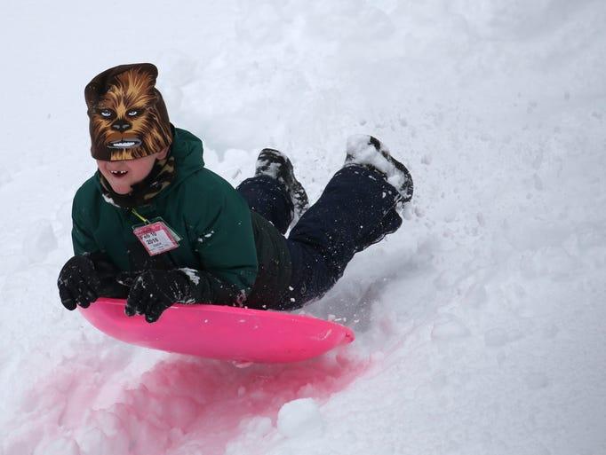 Finn Dreywood enjoyed sledding at Powder Mill Park