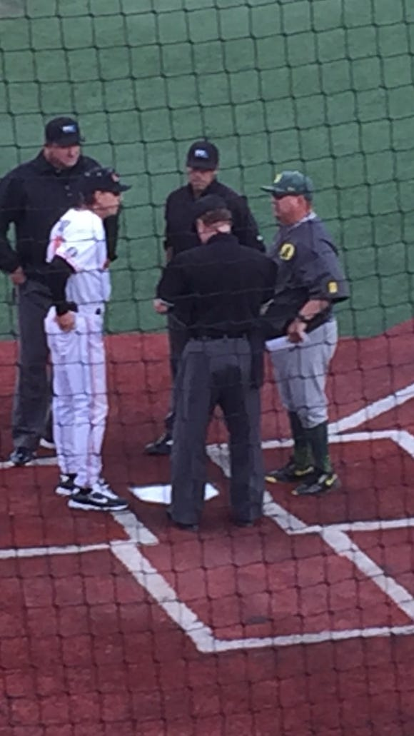 Oregon State baseball coach Pat Casey (left) and Oregon coach George Horton meet before Friday's game at Goss Stadium.m