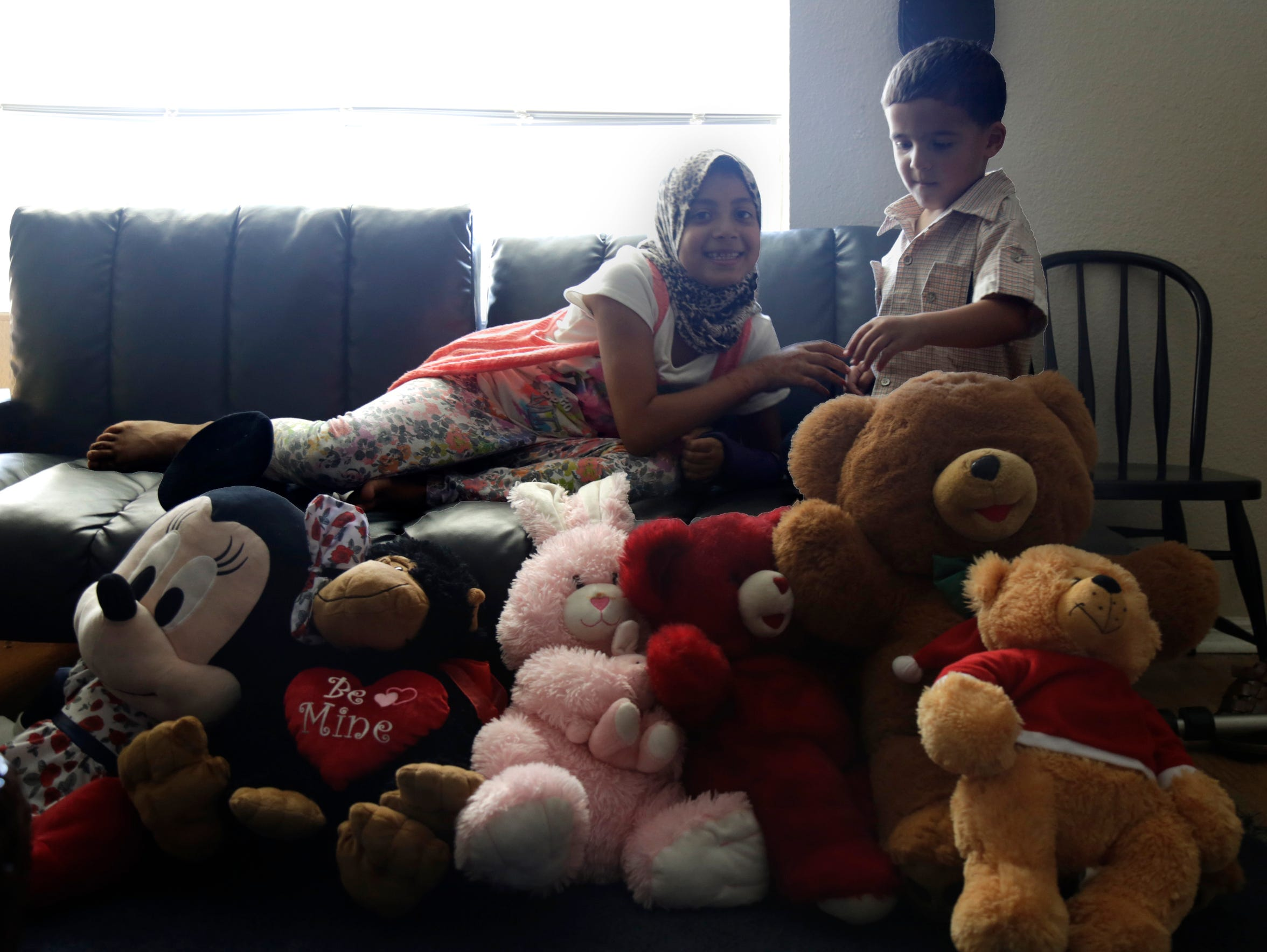 Heba Almasri, 9, and her brother Mohannad Almasri,