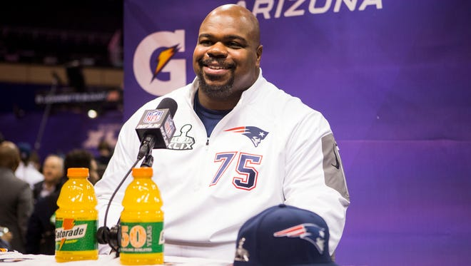 New England Patriots defensive tackle Vince Wilfork speaks to the media at Super Bowl Media Day at US Airways Center on Jan. 27, 2015, in Phoenix.