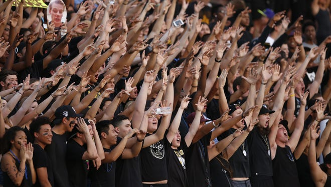 Tempe Marcos de Niza fans cheer during a high school football game against Phoenix Mountain Pointe on Aug. 21.