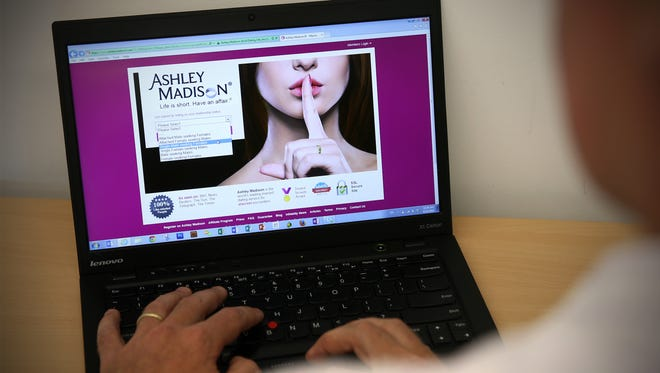 In this photo illustration, a man visits the Ashley Madison website.