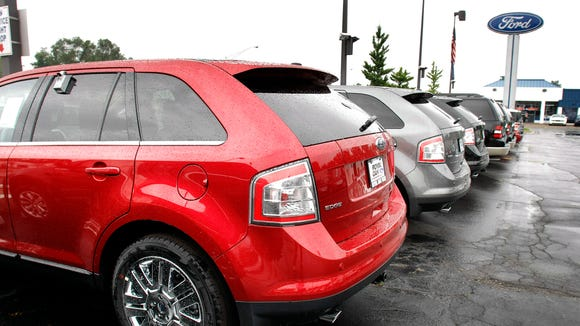 Ford is recalling 129,000 midsize SUVs in Delaware, other parts of the U.S. and Canada to fix potential fuel leaks.