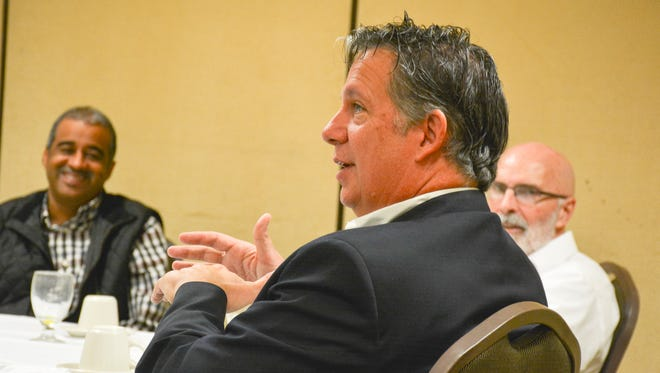 Mayor-President Joel Robideaux discusses priorities with newly-elected Lafayette City-Parish Councilmen Pat Lewis and Bruce Conque. Dec. 12, 2015.