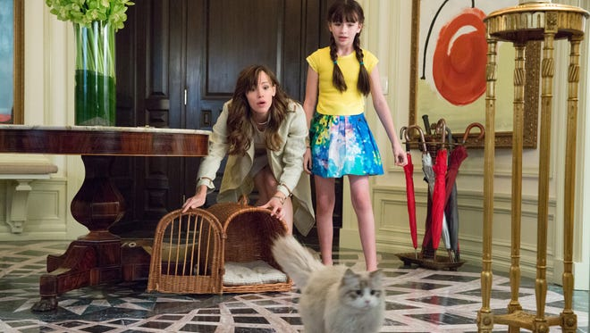 Jennifer Garner, left, and Malina Weissman play wife and daughter to Kevin Spacey's cantankerous cat in 'Nine Lives.'