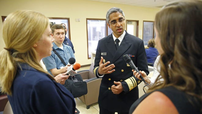 Jamie Pothast, director of crisis services (left), and Julie Wonsowicz, senior director of clinical services, talk with U.S. Surgeon General Vivek Murthy as he tours the Community Bridges Central City Addiction Recovery Center on Monday, June 13, 2016, in Phoenix.
