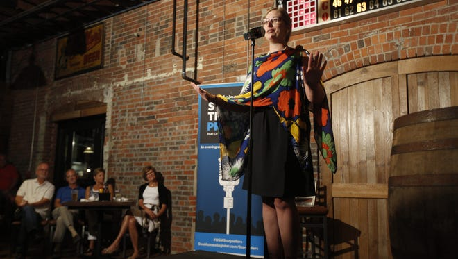 """Jess Rundlett tells the story of moving forward after her bicyclist boyfriend died from injuries sustained from a drunk driver. Rundlett was one of six tellers during The Des Moines Register's Storytellers Project event, """"Climb That Hill,"""" on Monday, July 11, 2016, at the Iowa Taproom in downtown Des Moines."""