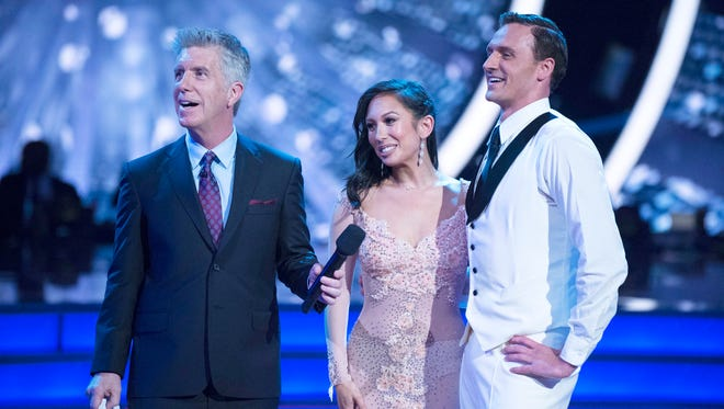 "In this Sept. 12, 2016 photo released by ABC, host Tom Bergeron, from left, appears with Cheryl Burke and US Olympic swimmer Ryan Lochte during a broadcast of the celebrity dance competition series, ""Dancing with the Stars,"" in Los Angeles."