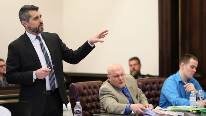 Coshocton County Prosecutor Jason Given, left, questions a witness Tuesday during a trial for Nathan D'Ostroph, 24, seated next to defense attorney Dan Guinn. D'Ostroph has been charged in the murder of a seven-month-old.