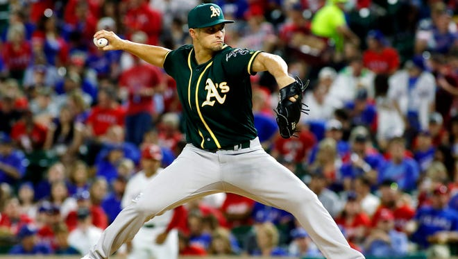 Oakland Athletics starting pitcher Kendall Graveman (49) pitches in the seventh inning against the Texas Rangers at Globe Life Park in Arlington.