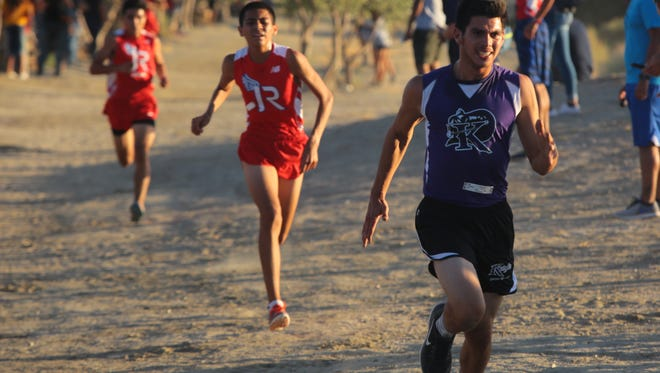 Luis Fernandez kicks to the finish in the second Desert Valley League cross country meet of the season, Wednesday, October 11, 2017.