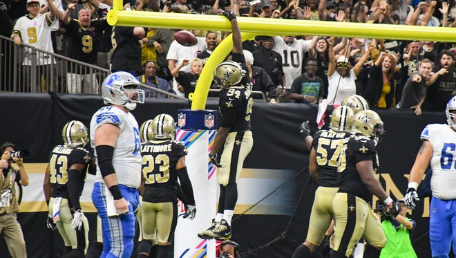 Defensive end Cameron Jordan dunks the ball over the goal as the New Orleans Saints take on the Detroit Lions in the Mercedes-Benz Superdome. Sunday, Oct. 15, 2017.