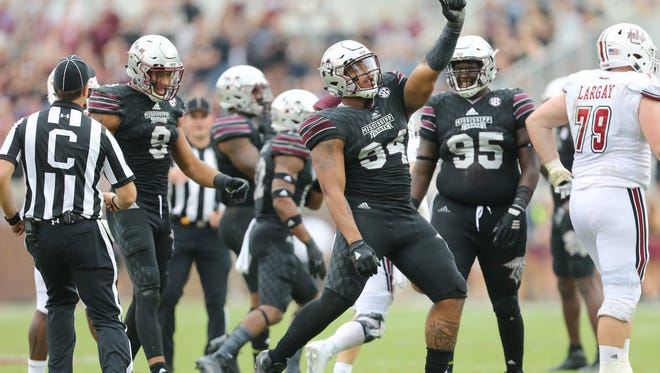 Mississippi State's Jeffery Simmons (94) celebrates after tackling UMass's Ross Comis (2).
