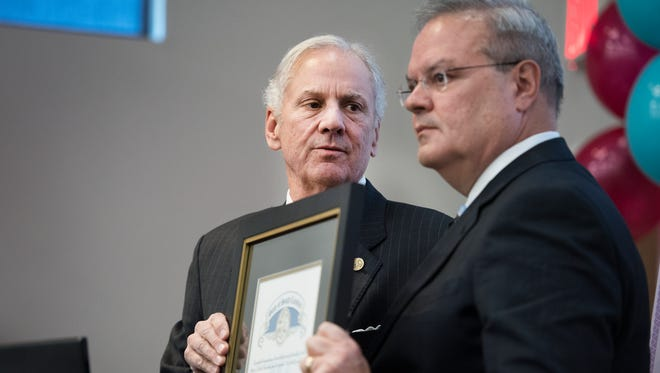 Governor Henry McMaster awards Peter Larocque, president of North American Technology Solutions at SYNNEX Corporation, with an Order of the Palmetto during the SYNNEX Share the Magic event on Thursday, December 14, 2017.