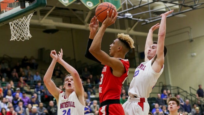 Center Grove's Trayce Jackson-Davis goes up for a shot during the Trojans' sectional win over Martinsville on Tuesday.