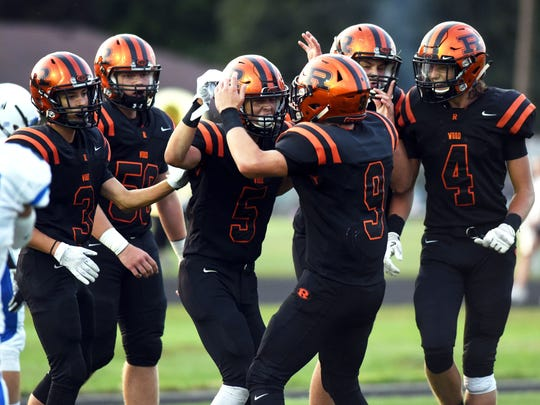 Ridgewood's Zach Wright (5) is congratulated by teammates