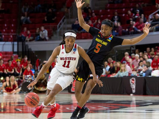 North Carolina State's Kiara Leslie (11) dribbles around Maryland's Kaila Charles (5) during the second half of a second-round game in the NCAA women's college basketball tournament in Raleigh, N.C., Sunday, March 18, 2018. North Carolina State defeated Maryland 74-60. (AP Photo/Ben McKeown)