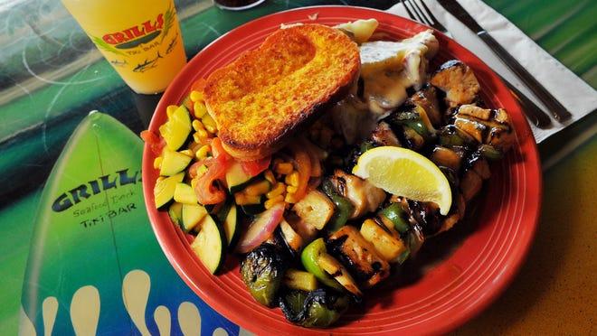 Grills Seafood Deck & tiki Bar at Port Canaveral Shark Kabobs with tahiti taters and veggies .
