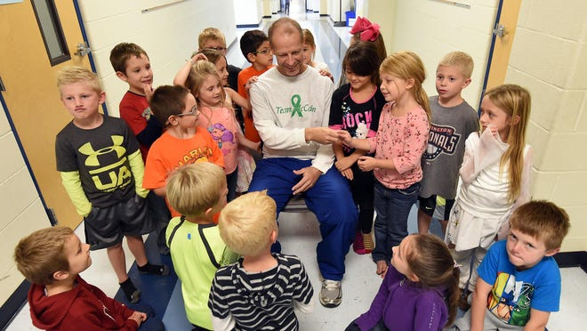 Students at Nelson-Wilks-Herron Elementary School welcomed physical education teacher Marcus McCain back to school in October. McCain returned to work for the first time in more than a month after battling a kidney disease. McCain is on a list for a kidney transplant.