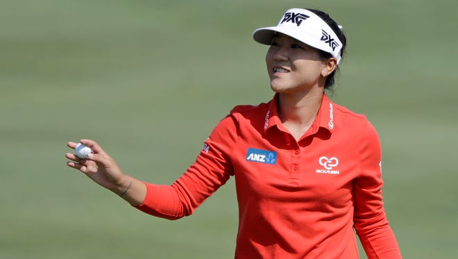 Lydia Ko, of New Zealand, smiles after making a birdie the fifth hole during the second round of the Indy Women in Tech Championship golf tournament, Friday, Sept. 8, 2017, in Indianapolis. (AP Photo/Darron Cummings)