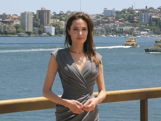 Angelina Jolie, seen in this 2014 photo posing in Sydney, Australia, disclosed this week she had undergone surgery to remove her ovaries and fallopian tubes to help reduce her chances of getting cancers.