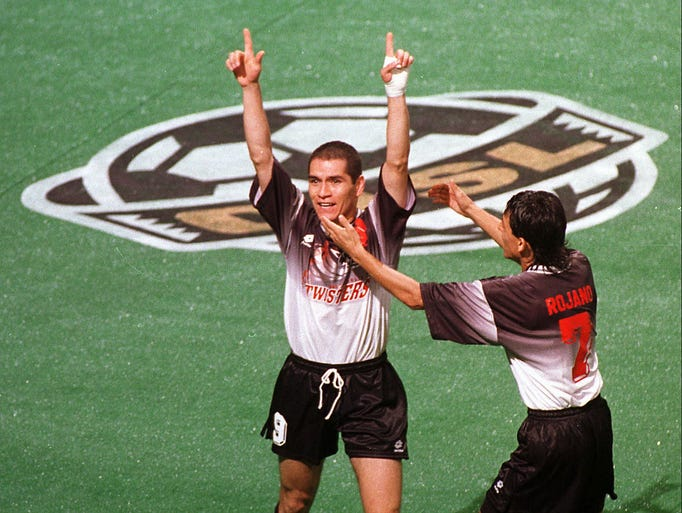 Indianapolis Twisters midfielder Alejandro Moreno, left, celebrates his goal tied the game with the Washington Warthogs at 1-1 in the first quarter of the first home game June 21, 1996 at Market Square. Teammate Jose Luis Rojano congratulates Moreno.