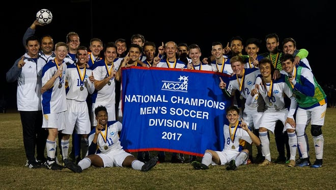 The Pensacola Christian College men's soccer team celebrates after winning the NCCAA Division II national title on Nov. 18 in Greenville, S.C.